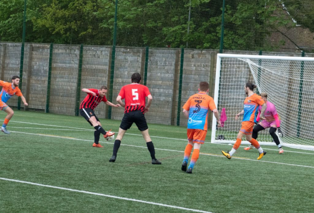 Adam Norwood fires home the fourth